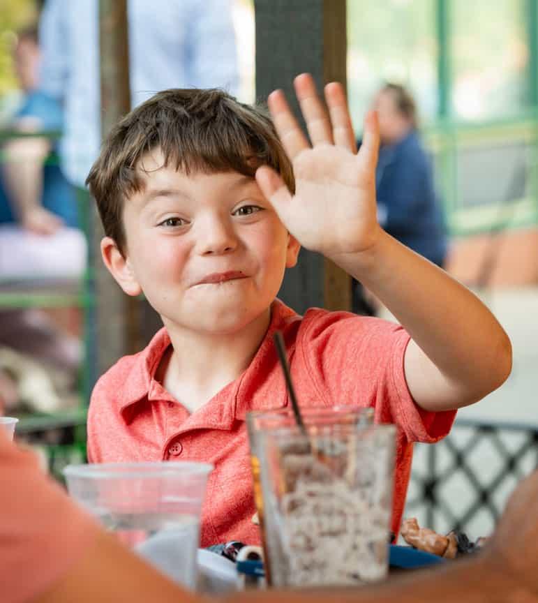 Kid waving Brookline